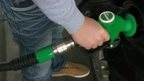 Man filling up car with unleaded petrol