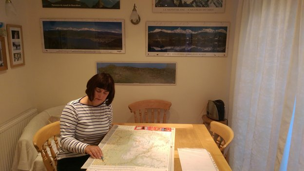 John's wife Madeleine with maps of Nepal