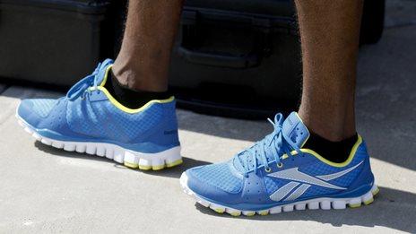 Adidas shares up on Reebok bid speculation - BBC News