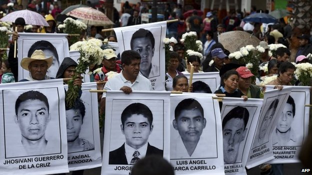 Parents and relatives of the 43 missing students arrive for a mass at Basilica of Guadalupe in Mexico City on 19 October, 2014.