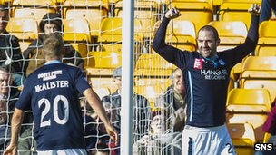 Jim McAlister and Dundee goalscorer Gary Harkins