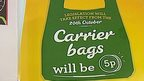 Bag with message announcing introduction of 5p charge for plastic carrier bags in Scotland