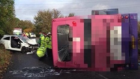 Police examine the overturned bus