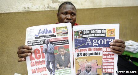 Newspaper vendor in Angola