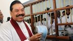 Sri Lankan President Mahinda Rajapaksa (R) after buying the first ticket for the Yal Devi train at the newly reconstructed railway station in Jaffna, Sri Lanka, 13 October, 2014