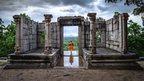 Buddhist monk walking through temple (c) BBC