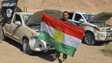 Peshmerga fighters with captured IS vehicles near Tikrit, Iraq - 8 October