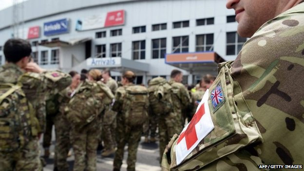 A handout picture from Britain's Ministry of Defence shows British military personnel of 22 Field Hospital arriving in Sierra Leone