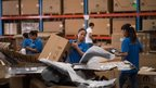 Chinese workers packing goods at a warehouse in the Shanghai Pilot Free Trade zone