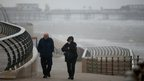 Visitors brave high winds and rain on Blackpool promenade