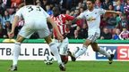 Stoke winger Victor Moses was awarded a penalty after this challenge by Swansea defender Angel Rangel