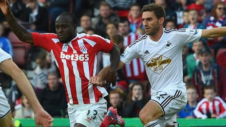 Stoke winger Victor Moses (left) went down following a challenge by Swansea defender Angel Rangel