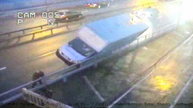 Van blown by wind