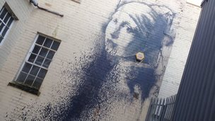 Banksy's Pierced Eardrum with paint thrown over it