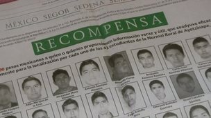 Picture of a newspaper advertisement offering a reward for information on 43 missing Mexican students