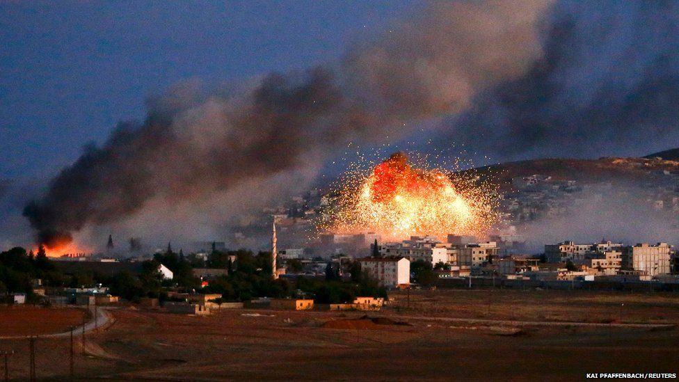 Smoke and flames rise over Syrian town of Kobane after an airstrike