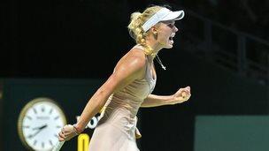 Caroline Wozniacki of Denmark reacts to a point against Maria Sharapova