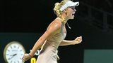 Caroline Wozniacki of Denmark reacts to a point against Maria Sharapova