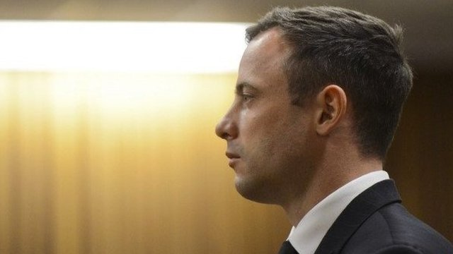 Oscar Pistorius stands in the dock as his sentence is delivered at the North Gauteng High Court in Pretoria, South Africa, 21 October 2014