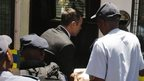 Pistorius gets into police van after leaving court - 21 October
