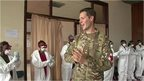 A soldier teaching health workers