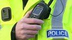Policeman's hand and radio and jacket