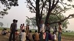 Villagers collect near tree where the girls were found in Badaun