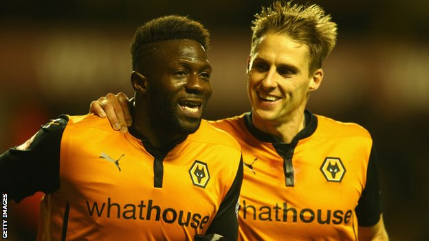 Bakary Sako of Wolverhampton Wanderers celebrates his goal with team-mate Dave Edwards