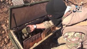 Grab from video shows militant with apparent US cache - 21 October