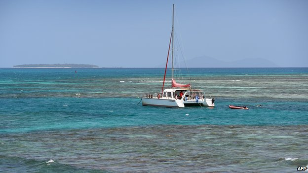 A photo taken on 22 September 2014 shows a tourist boat anchored on Australia's Great Barrier Reef