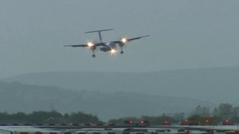 Plane comes in to land at Manchester Airport
