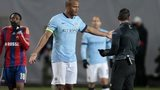 Manchester City's Vincent Kompany talks to a referee in Moscow
