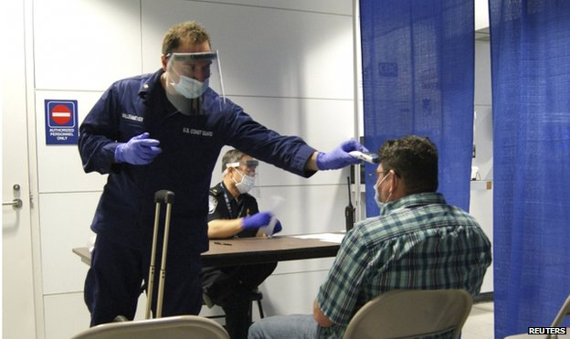 A passenger arriving from Sierra Leone is screened at O'Hare International Airport in Chicago on 16 October 2014.