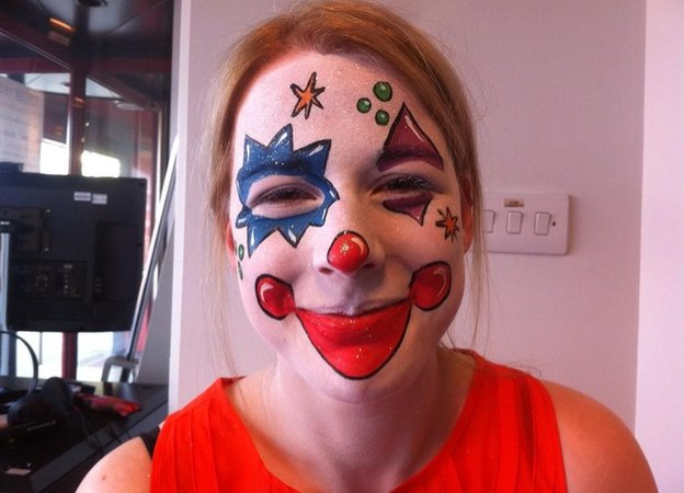 Louise, dressed as a clown