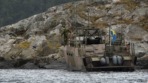 An assault vehicle lands an search team on an island in Stockholm's archipelago