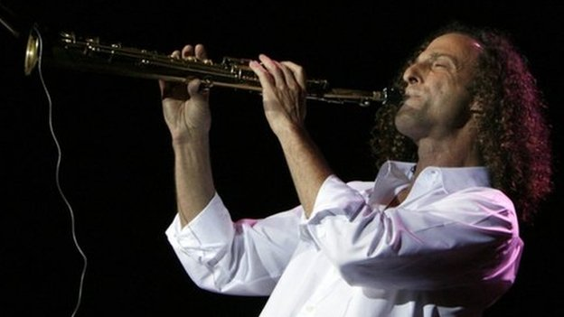 "U.S. jazz musician and saxophonist Kenneth Gorelick, known as Kenny G, performs during a concert in Hong Kong as part of his ""Rhythm and Romance"" world tour in this 9 May 2008 file photo"