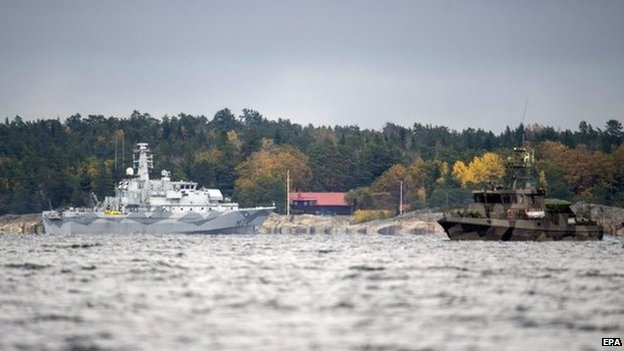 A Swedish minesweeper and guard boat searching for the mystery vessel