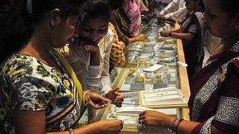Indian women choosing jewellery