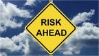 "Road sign saying ""risk ahead"""