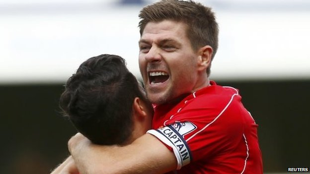 "Liverpool""s Philippe Coutinho (L) celebrates with Steven Gerrard"
