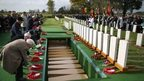 Descendants of the soldiers lay wreaths during the reburial ceremony near Lille