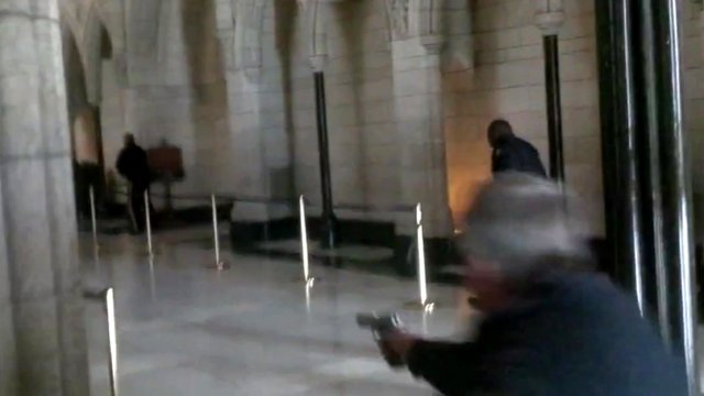 Bullets being fired inside the Canadian parliament building
