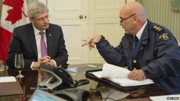 Canadian Prime Minister Stephen Harper with Royal Canadian Mounted Police commissioner Bob Paulson