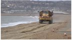Truck dumping shingle on Seaford beach