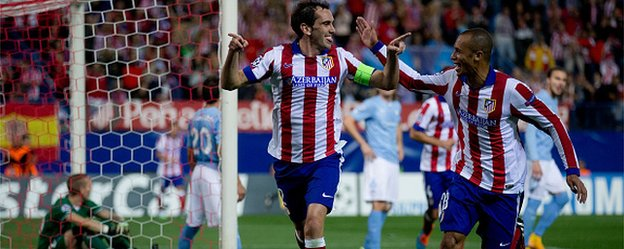 Captain Diego Godin celebrates scoring Atletico Madrid's fourth goal against Malmo with teammate Joao Miranda