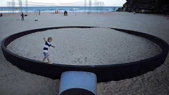 Giant frying pan on beach