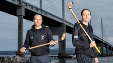 Gary Innes (right) does a spot of posing in his Scotland shinty kit