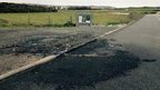 Damage to Guernsey road caused by car fire