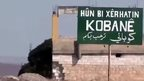 Sign showing southern entrance to Kobane (2 October 2014)