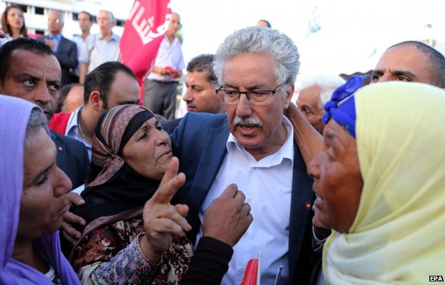 Tunisian leader of Popular Front party and its presidential candidate Hamma Hammami (C) with supporters during a parliamentary election campaign rally in Sousse south of Tunis ,Tunisia 16 October 2014.